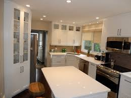 Transitional White Kitchen - hawthorne appliances for a transitional kitchen with a caesarstone