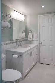 Wall Mounted Vanities For Small Bathrooms by White Stained Wooden Bathroom Vanity Under Wall Mounted Mirror
