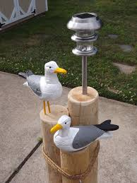 light post with address sign nautical lawn piling with seagulls solar light and address plaque