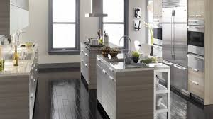 gray kitchen cabinets with black counter white spray paint wooden