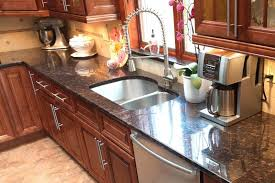 what color countertops go with brown cabinets brown granite countertops pictures cost pros and cons