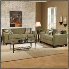 pillows in mix of living room ideas dark green couch sage green