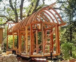 curved roof tiny house under construction u2013 incredible carpentry