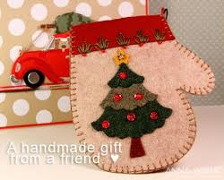 handmade mitten with tree ornament