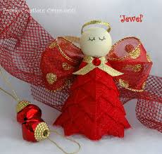 sparkling like red and gold u0027jewels u0027 this beautiful angel