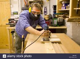 Custom Cabinet Makers Craftsman Uses A Router With A Custom Made Jig To Cut A Housing