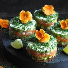 rye bread canapes a starter of salmon and avocado on rye bread in