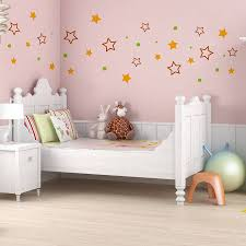 Pink Laminate Flooring Star In Pink Wall Paint Interior Decor With White Bedstead And