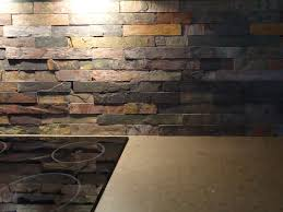 favored stacked stones slate backsplash with electric top stove on
