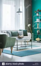 light blue decorative balls metal marble table with decorative balls in bowl in green living