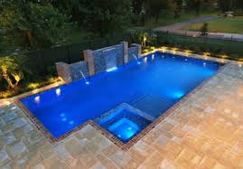 the great pool deck debate concrete vs pavers new orleans