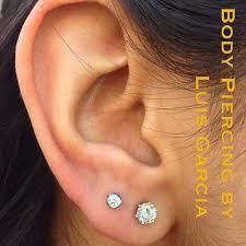 two earrings two earrings best 25 pierced earrings ideas on