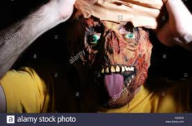 person wearing scary mask for halloween stock photo royalty free
