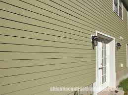 exterior design beige hardie plank siding and front doors for