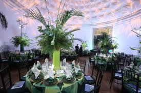 six foot centerpieces of ferns bamboo and other greenery in
