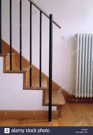 Banisters Simple Metal Banisters On Wooden Staircase In Townhouse Hall Stock