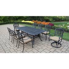 rst brands deco 9 piece patio dining set with tika orange cushions