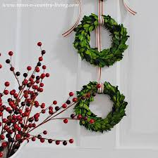 boxwood wreaths diy christmas decor trio of boxwood wreaths town country living