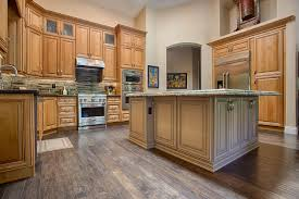 savano kitchen cabinets with a natural stain and brown glaze