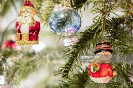 christmas baubles and santa claus hanging on christmas tree munich