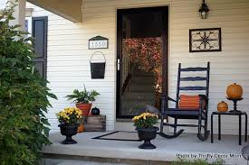 turn fall decorating ideas into halloween decor on your front porch