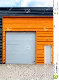 modern warehouse entrance with orange front stock photo image