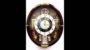qxm488brh seiko melodies in motion wall clock