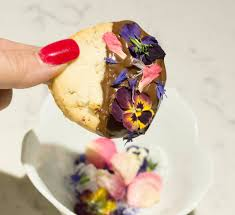 chocolate dipped pecan shortbread cookies with edible flowers