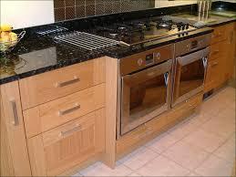 white kitchen cabinets and ubatuba countertop unique home design