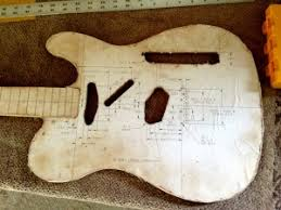 cutting out the guitar body from a block of wood hellecaster u0027s