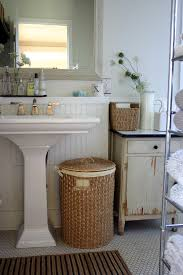 mirrored medicine cabinet in bathroom farmhouse with pedestal sink