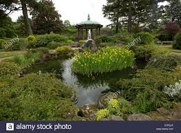 park with bandstand rock garden trees shrubs and ornamental