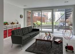 interior design portfolio of mimalist livg room with dark sofa