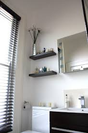 tiles stowed page 2 ecowood blinds a wenge cabinet and dark wood floating shelves keep the look crisp and
