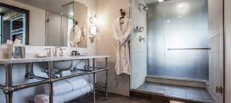 designing a bathroom hotels tackle unique bathroom design challenges delaram design