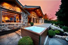 beautiful outdoor jacuzzi in the backyard garden provides restful