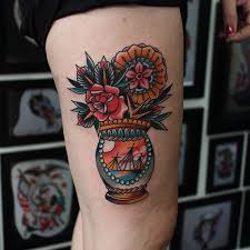 flower bouquet tattoo idea