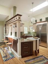 kitchen style medium tone wooden paneled cabinets stainless steel