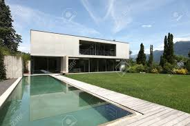 modern house with pool and garden stock photo picture and royalty