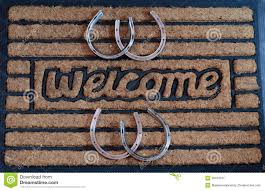 welcome door mat with horseshoes stock photo image 39410521