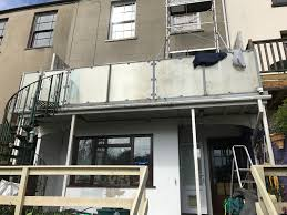 External Painting Of A Three Storey House In Pembrokeshire