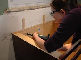 how to fix kitchen base cabinets to wall how to install kitchen cabinets hgtv