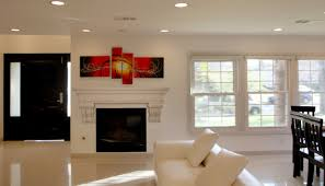 interior white concrete fireplace mantels with screen fireplace