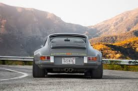 old porsche 911 wide body driving the 1990 porsche 911 reimagined by singer vehicle design