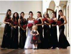 and black wedding wedding party portrait with and groom in front of