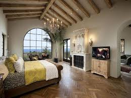 mediterranean master bedroom with french doors u0026 hardwood floors