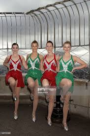 the rockettes visit the empire state building in celebration of