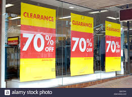 window posters clearance sale posters in shop window stock photo royalty free