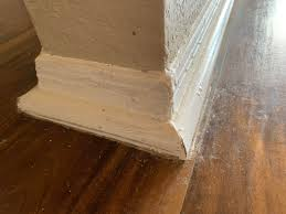 kitchen cabinet baseboards how to fix globing paint on baseboard and kitchen cabinets