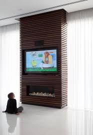 design idea the wood slats on this tv and fireplace surround